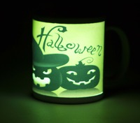 "Our new Glow-in-the-Dark sublimation ceramic mug! Prepare to be amazed by the results! After applying a suitable image (for best results, include bright white areas in the image to allow for the ""glow-in-the-dark"" treatment to shine) expose the mug to any light source and view in a darkened room."